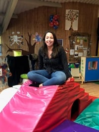 Ellen sitting on soft play