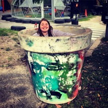 Christy in giant pot in playground