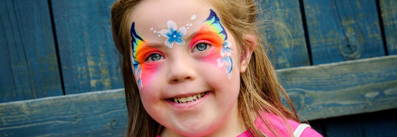 Child wearing butterfly face paint